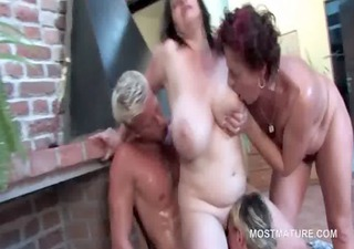 Slutty mature fucked doggy style in outdoor orgy